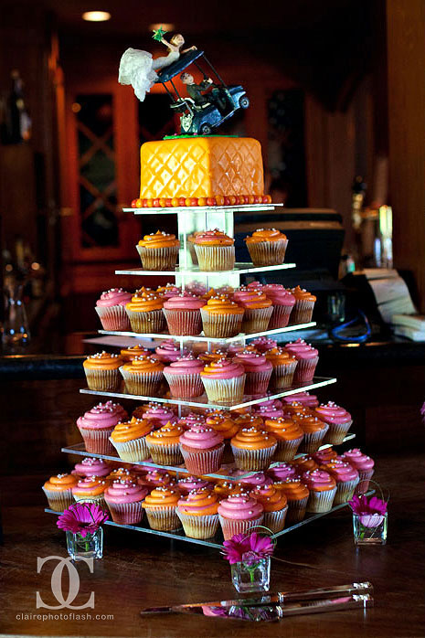 cupcakes with a cake on top + and a cool caketopper too