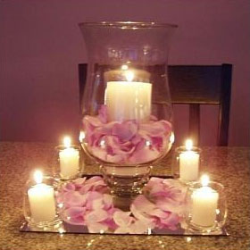 Combination candle in a vase of flower petals DIY wedding centrepiece idea