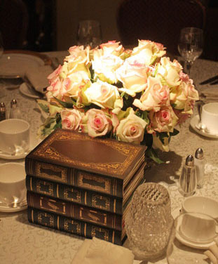 Old books and flowers: themed wedding centrepiece