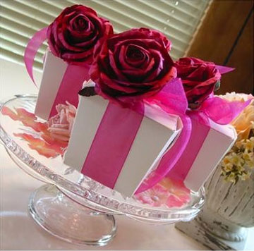 Pink roses on ribboned boxes, DIY wedding centrepiece