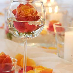 Rose floating in big wine glass, DIY wedding centrepiece idea