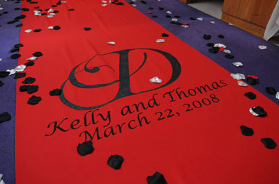 Red, personalized aisle runner for the wedding ceremony