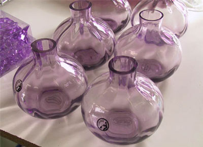 wedding colors: purple glass vases