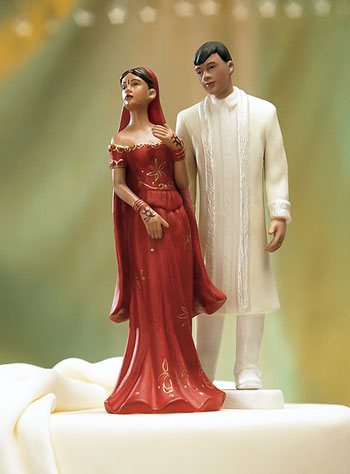 Traditional indian couple wedding caketopper