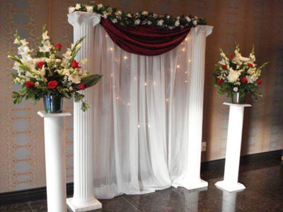 Wedding Ceremony flower arrangements on pedestals