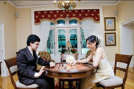 wedding couple playing checkers