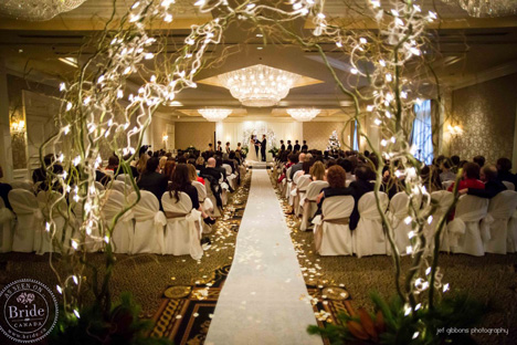 Wedding reception, white chair covers, with muted gold accents
