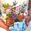 The bouquets included cedar bark roses hand-woven by Lucy, her sisters, and other women in her family.
