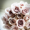 The classic bouquet of pink roses by Wedding Design Studio fit the fairytale romance of the day