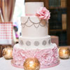 The cake by Kien and Sweet shows the perfect balance of elegance and light heartedness that embodies the couple.