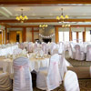 The Fraser room has an elegant feel with its chandeliers and wooden beam accents.
