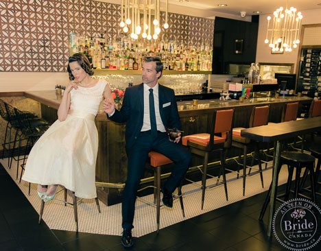 Bride and groom in fifties bar, sitting on on bar stools
