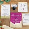 Golden sparkle adds a swoon-worthy element to this invitation suite by DistInk Designs.