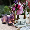 Gold cutlery and purple votives are the perfect complement to this gorgeous design.
