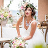 Pastel tones and the Michelle dress by Truvelle fit the Tuscan wedding theme perfectly.