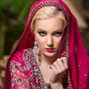 A bright pop of color on the lip was the perfect choice to compliment the striking dupatta and lehenga